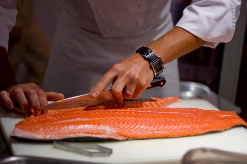 Preparing fresh salmon fillets