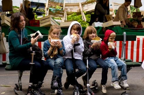 Children eating at markets