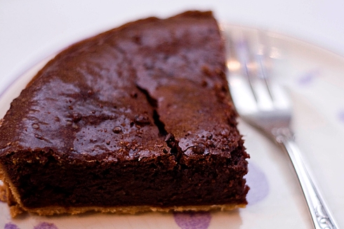 Piece of dark chocolate tart
