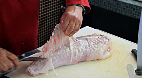 cutting skin of monkfish