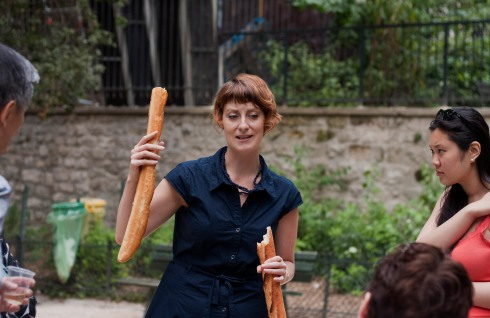 Meg Zimbeck comparing baguette quality on tour